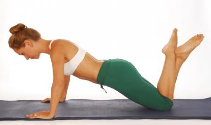 Girl doing Pilates exercise.