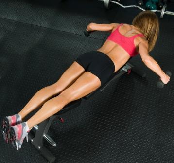 Woman doing rear deltoid exercises