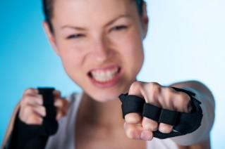Woman in workout gloves