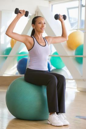 Woman exercising on stability ball