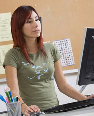 Woman working at stand up desk