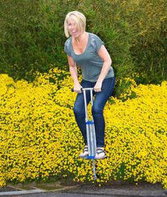 Woman using pogo stick for workout