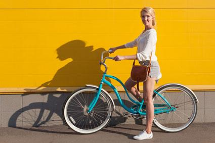 Woman with turquoise bicycle