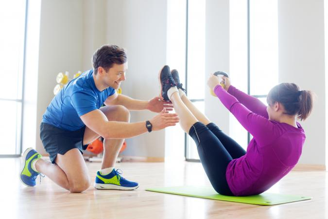 Personal trainer working with woman