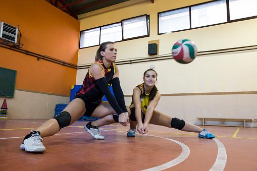 Two volleyball players during match