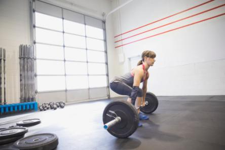 Woman practicing deadlifts