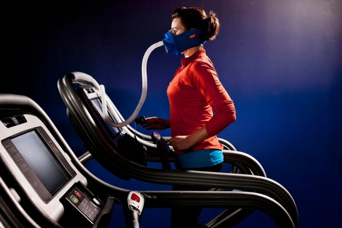 Woman running with oxygen therapy