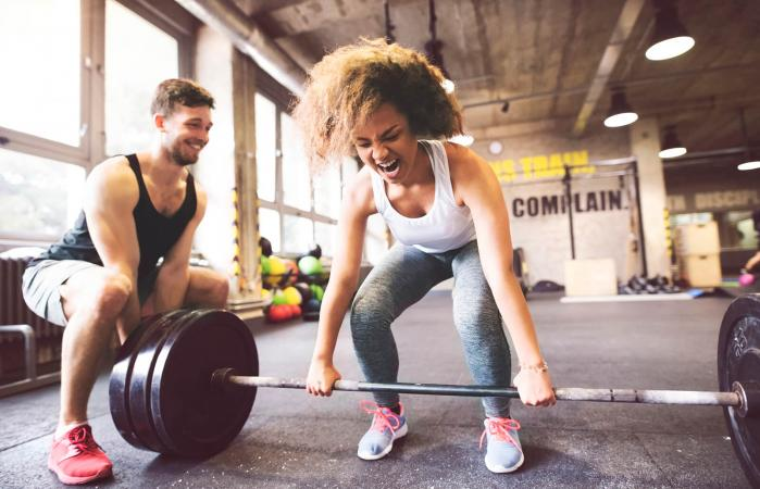 High intensity weight lifting in gym