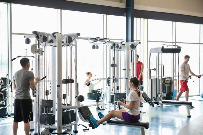 people using exercise machines at gym