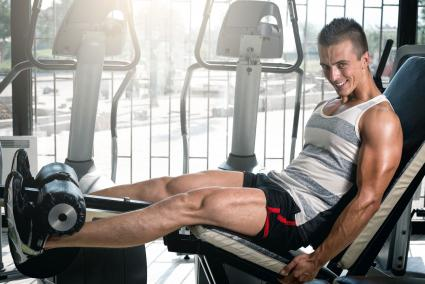 Man doing leg extension exercise
