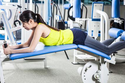 Woman doing leg curl at gym