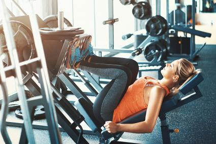Woman doing leg press exercise