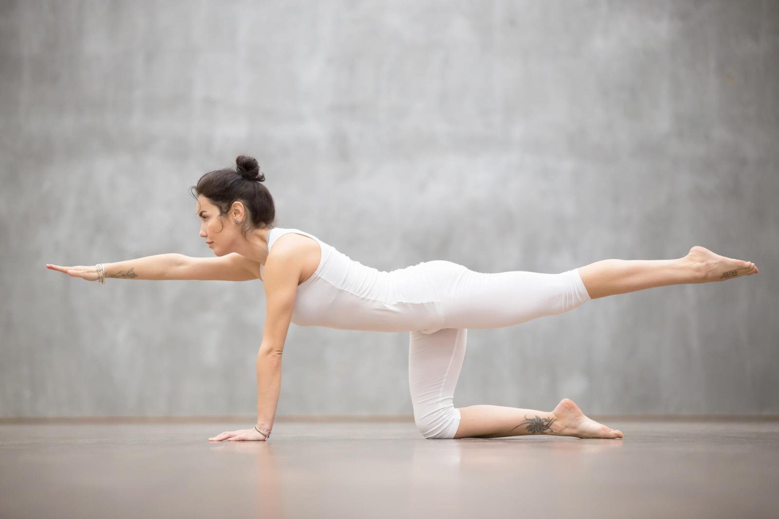 Woman doing Bird dog pose