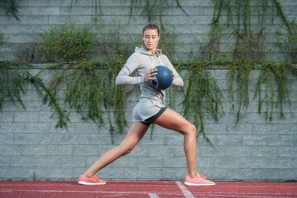 Ball lunge with oblique twist