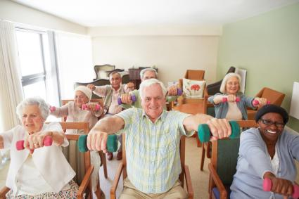 Dumbbell lifts in chairs with seniors