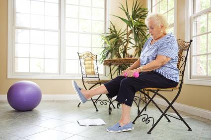 Senior exercising at home in a chair