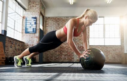 woman doing ball planks