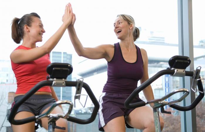 women on stationary bike