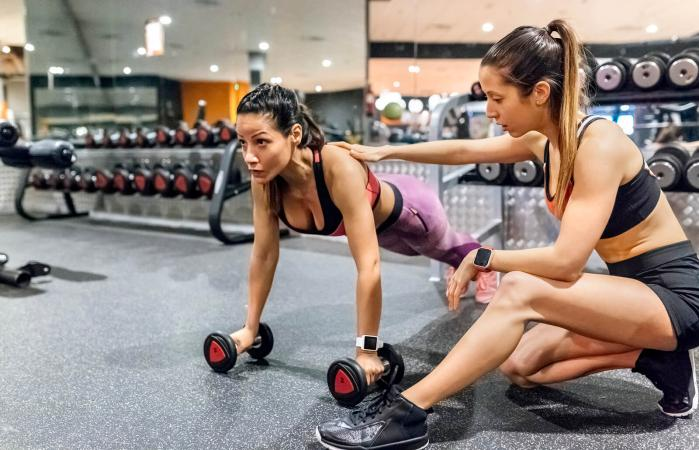 Woman with her trainer working out