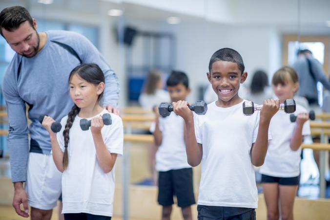 kids using dumbbells