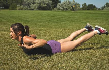 Woman performs back extension exercise