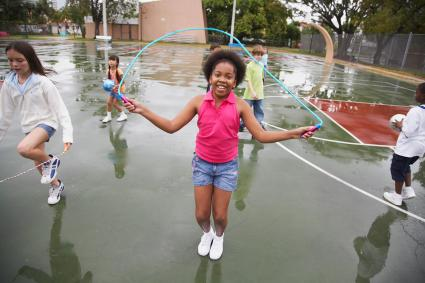 Girl jumping rope on playground