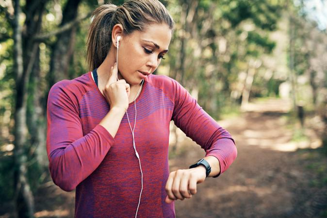 woman checking her heart rate