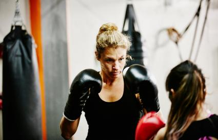 Female kickboxers training together in gym