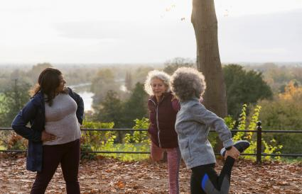 Active senior women friends stretching legs
