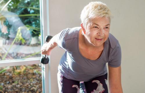 Senior Woman Exercising At Gym