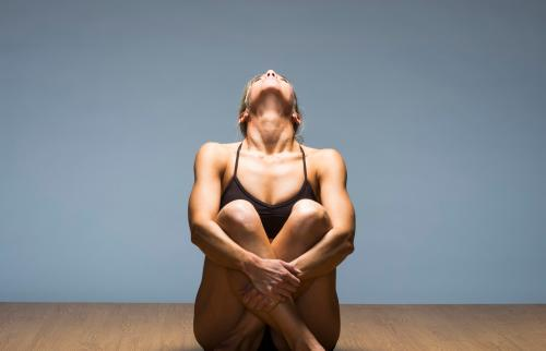 woman practicing neck, jowl and chin exercise