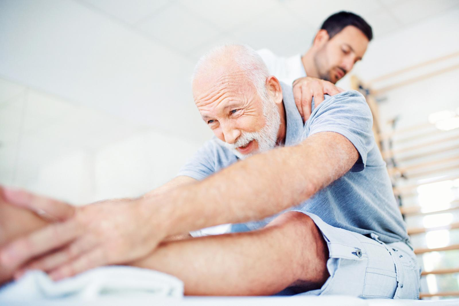 Senior gentleman having some back pain and a doctor