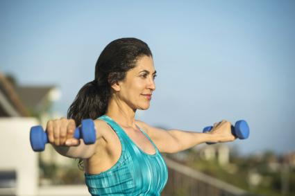 Woman lifting weights outdoors