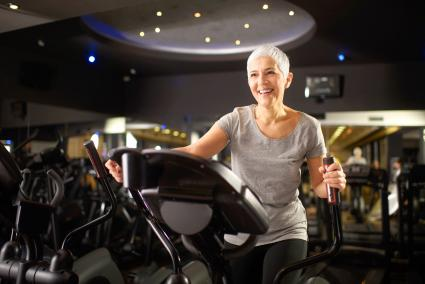 Senior woman exercising in a fitness center