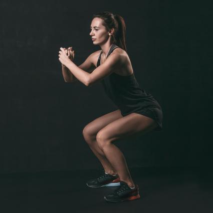 woman doing squat exercise