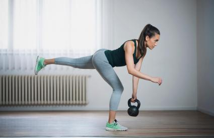 woman doing single-leg kettlebell deadlift