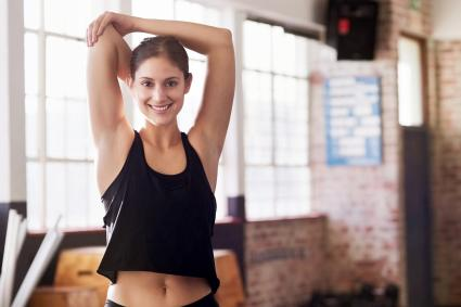 Woman doing static stretches before working out