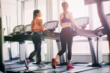 Girls exercising in the gym using a treadmill