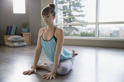 Woman practicing yoga in pigeon pose