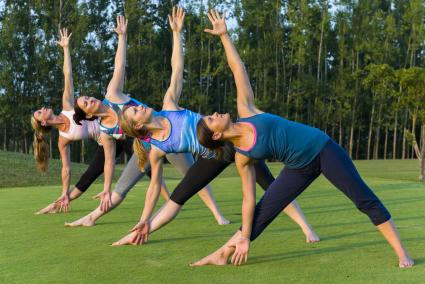 Exercise class practicing extended triangle pose
