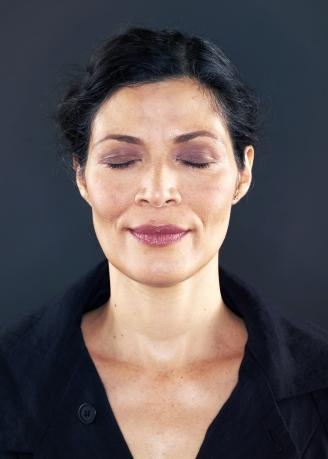 Woman with her eyes closed
