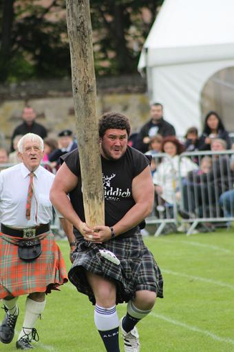 Testing Brute Strength at Highland Games in Inverness, Scotland