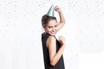 https://cf.ltkcdn.net/family/images/slide/191902-850x567-woman-dancing-with-festive-party-hat.jpg
