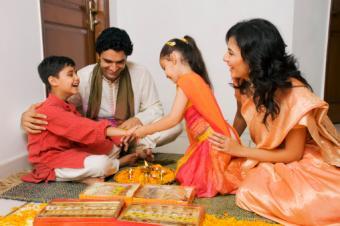 Girl tying a rakhi