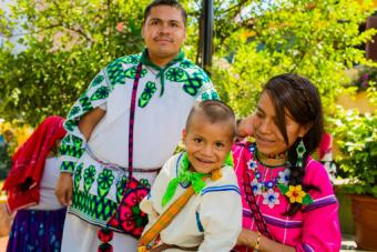 Wixaritari boy with family in traditional dress