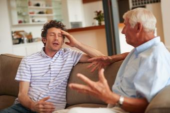 Annoyed son arguing with father