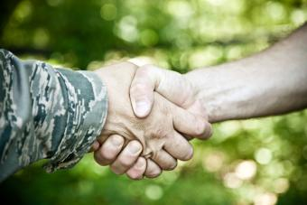 Military and civilian shaking hands