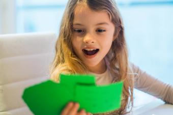 Little girl reading cards