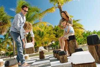 Family playing giant chess