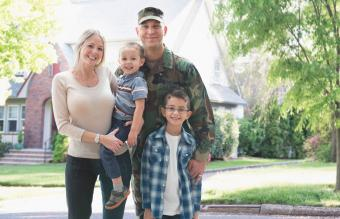 Soldier and family smiling